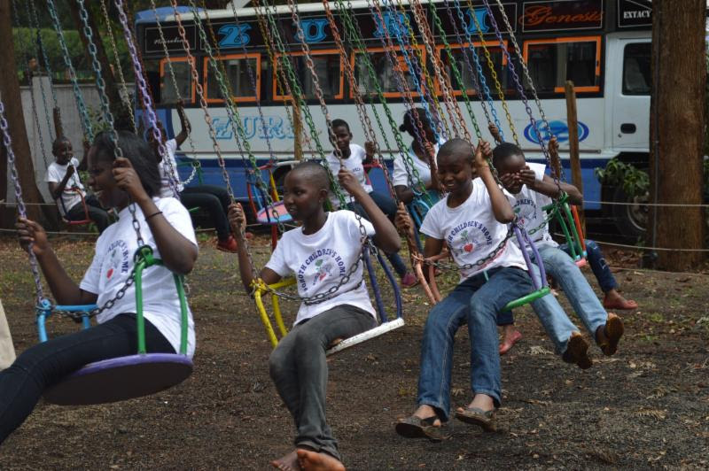 kids on swing in kenya